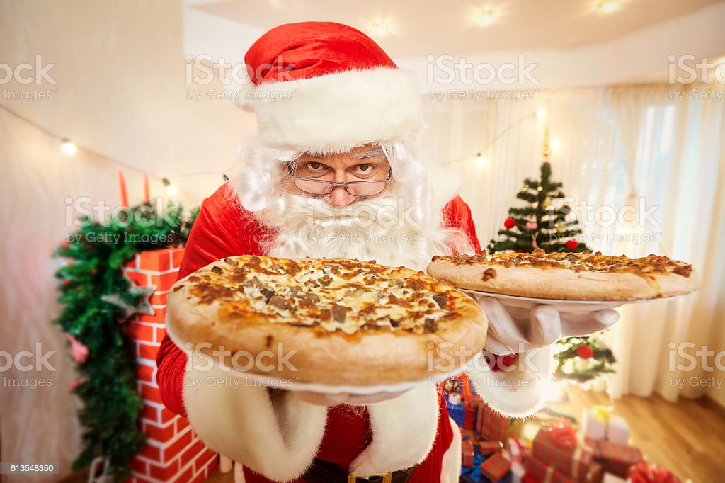 Pizza in  hands of Santa Claus  Christmas, happy new year – Foto