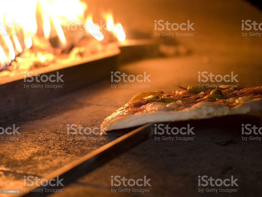 Pizza in the oven royalty-free stock photo