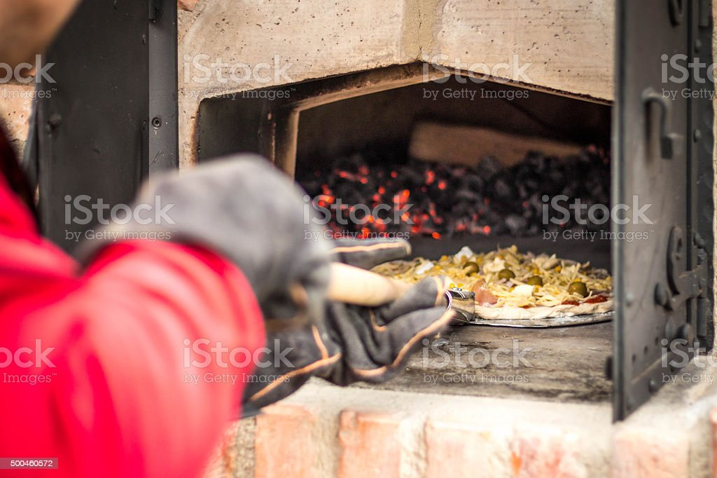 Pizza in the oven stock photo