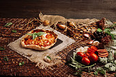 istock Pizza ingredients on table. Ingredients with pizza dough 1008257180
