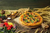istock Pizza ingredients on table. Ingredients with pizza dough 1008257520