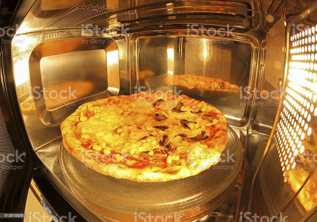 Pizza inside microwave stock photo