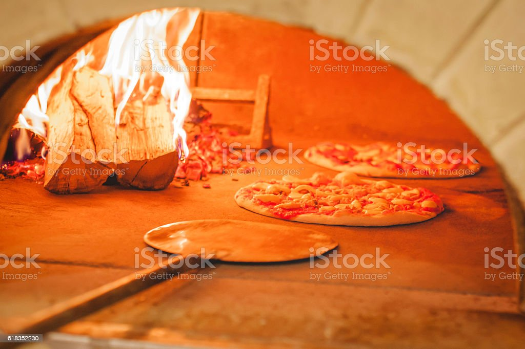 Pizza is cooked in the oven stock photo