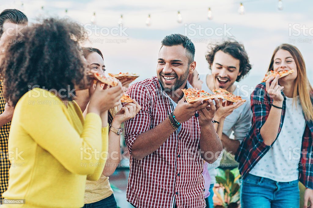 Pizza is more delicious with friends stock photo