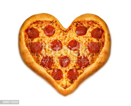 A aerial view of a heart shaped pizza on a white background with a clipping path.  Please see my portfolio for other food and drink images.