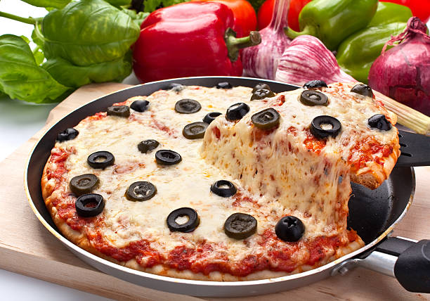 pizza margharita with black olives  one slice lifted up stock photo