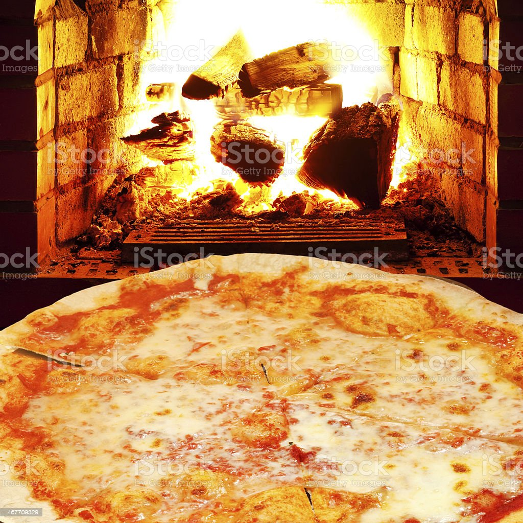 pizza margherita and open fire in stove stock photo