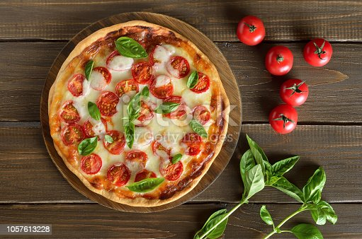 istock Pizza Margherita on a cutting board 1057613228