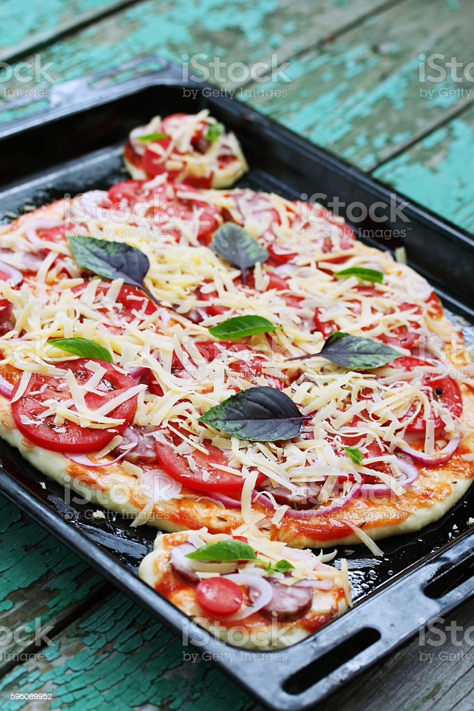 pizza on a baking sheet royalty-free stock photo