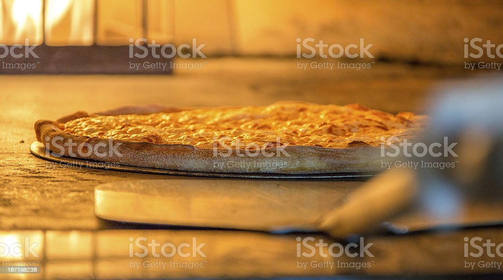 Pizza on a Brick Oven stock photo