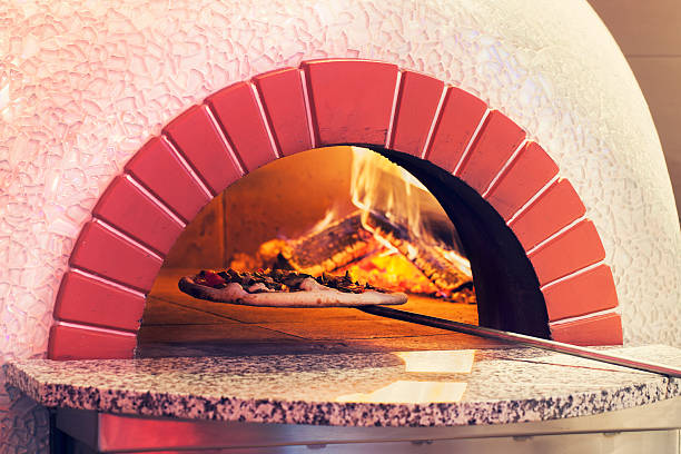 Pizza on brick oven stock photo
