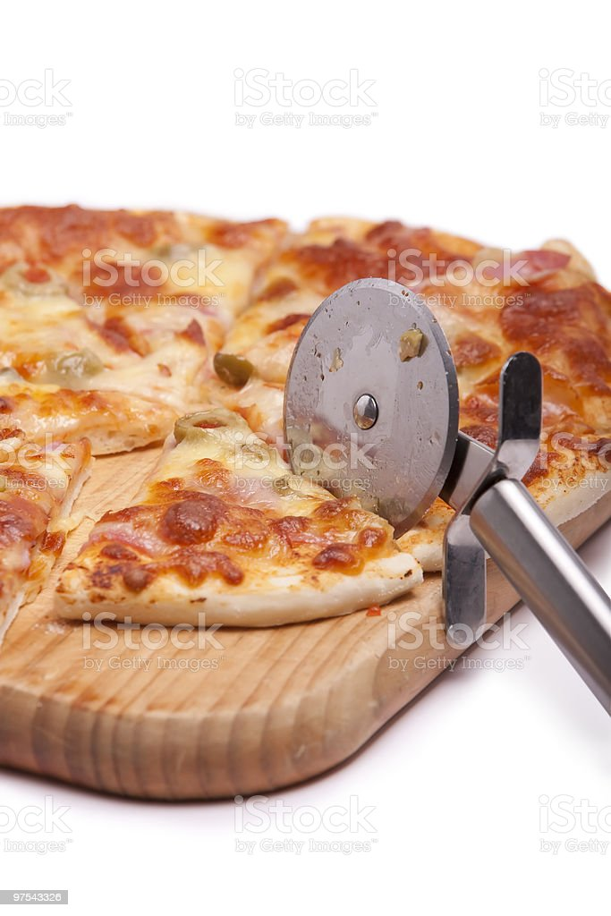 Pizza on wooden board with cutter royalty-free stock photo