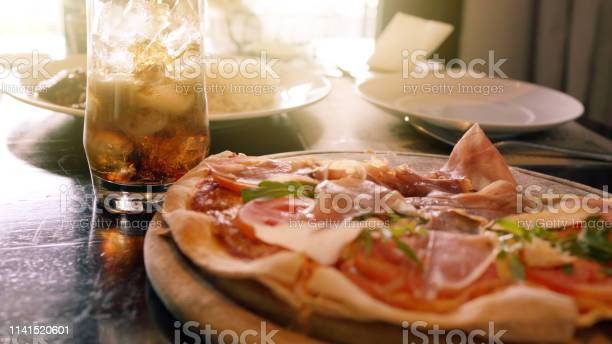 Photo of Pizza parma ham from the wooden pan the Italian food.