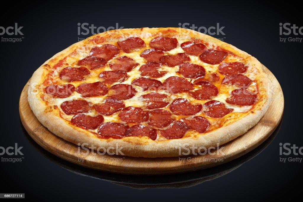 Pizza pepperoni, mozzarella, oregano stock photo