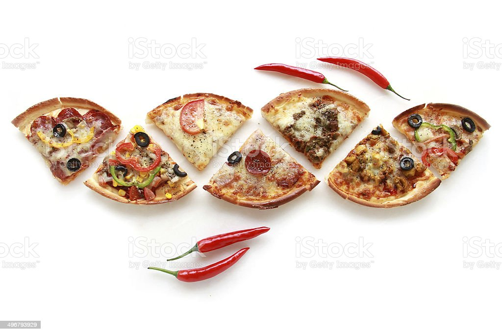 Pizza & Pieces of different pizzas & Arranged pieces & Red spicy Pepper stock photo