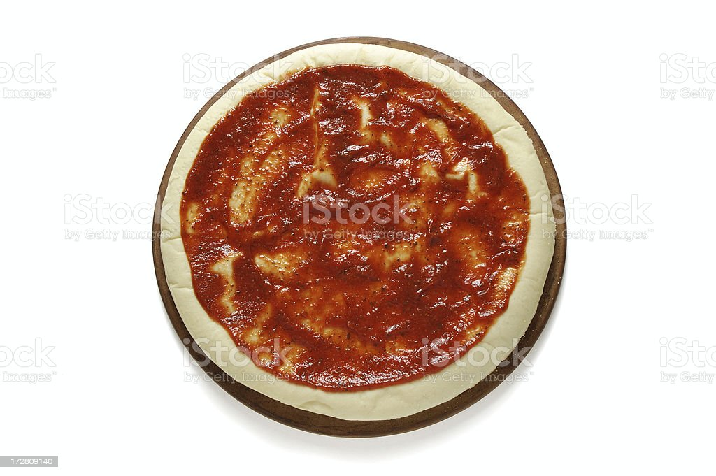 Pizza Preparation - Dough and Sauce royalty-free stock photo