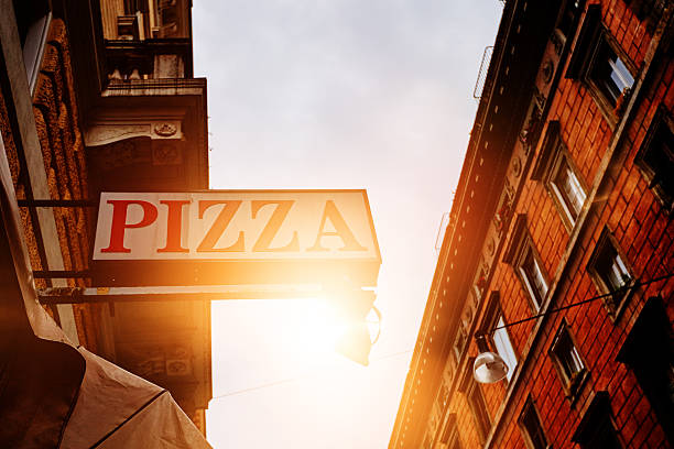 pizza restaurant in the town - pizzeria stock photos and pictures