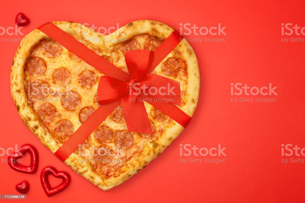 Pizza shaped heart with red bow ribbon for Valentine\'s Day romantic...