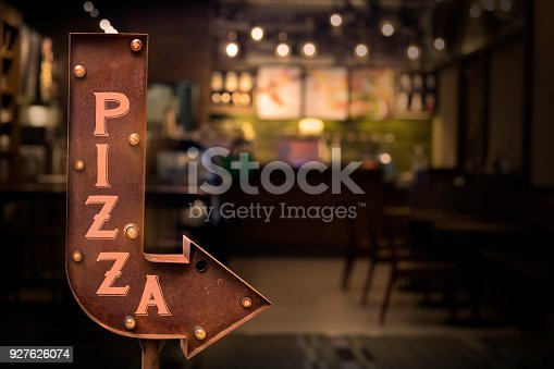 istock Pizza shop signboard, in front of the store 927626074