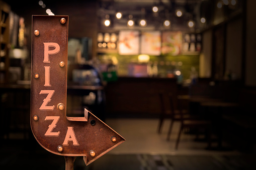 Pizza shop signboard, in front of the store