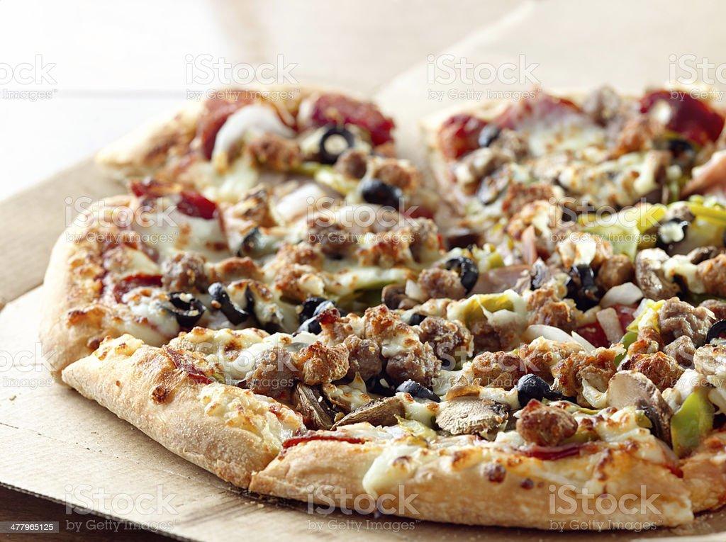 pizza sitting on cardboard box stock photo
