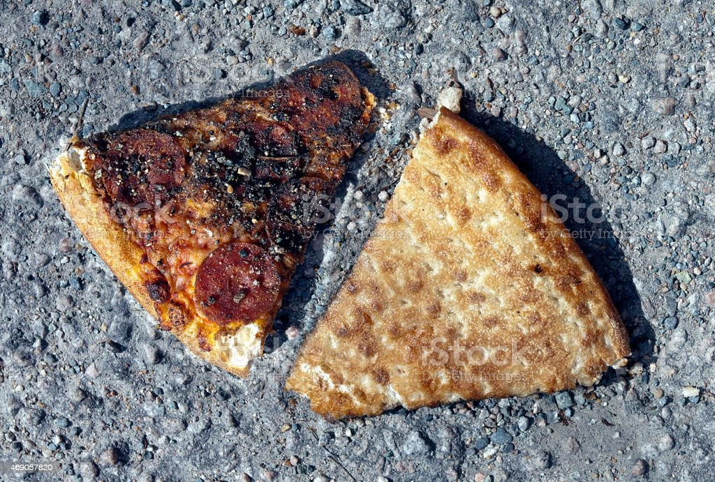 Pizza Slices in an Alley stock photo
