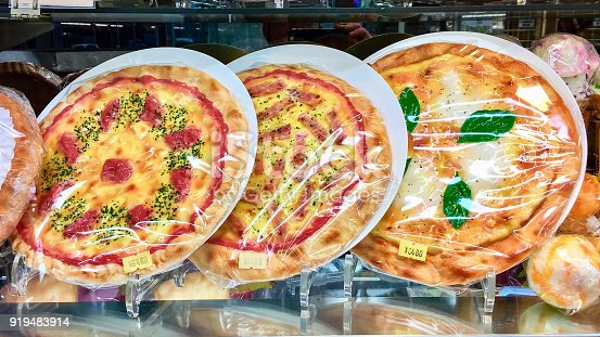 Pizza Time: realistic plastic imitation pizzas for display in restaurant windows for sale in Tokyo shop