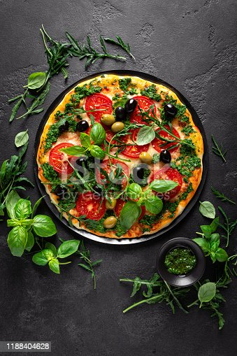 istock Pizza. Traditional italian pizza with green basil pesto sauce 1188404628
