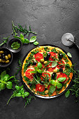 istock Pizza. Traditional italian pizza with green basil pesto sauce, top view 1184207696