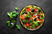 istock Pizza. Traditional italian pizza with green basil pesto sauce, top view 1184207928