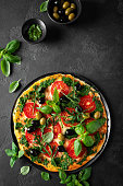 istock Pizza. Traditional italian pizza with green basil pesto sauce, top view 1193711663