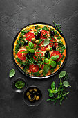 istock Pizza. Traditional italian pizza with green basil pesto sauce, top view 1202698566