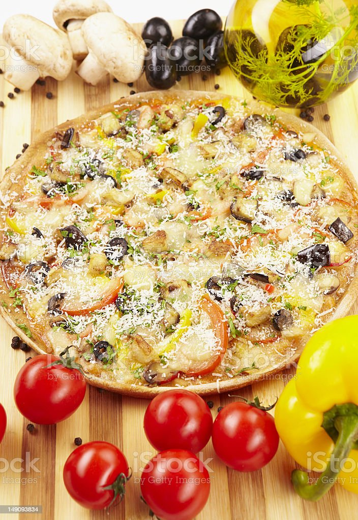 Pizza vegetarian with eggplant, olives, tomatoes royalty-free stock photo