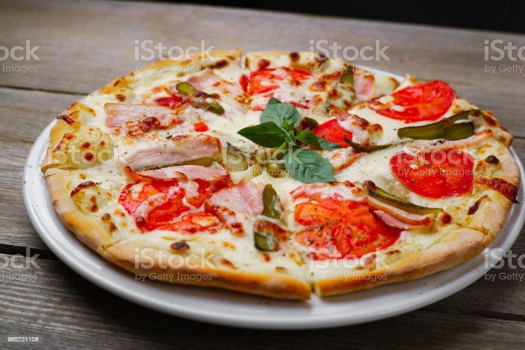 Pizza with bacon and gherkins, close up. zbiór zdjęć royalty-free