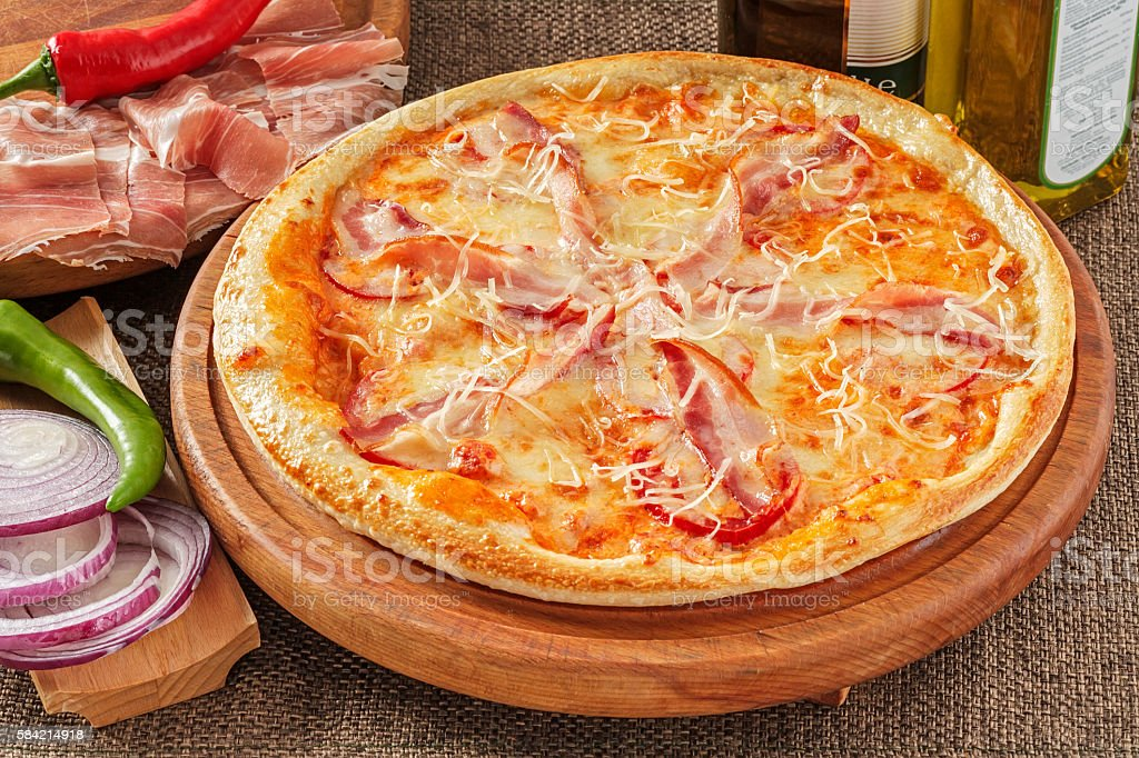 Pizza with bacon and pepper stock photo
