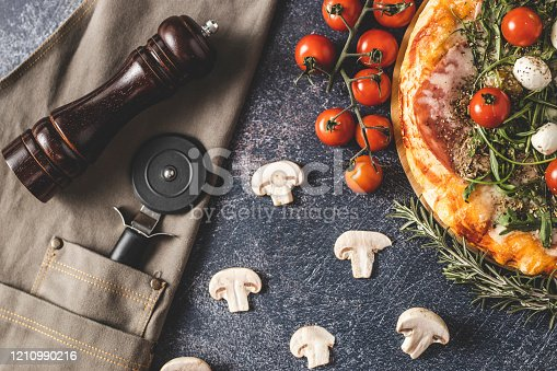 istock Pizza with cherry tomato and mushrooms 1210990216