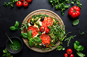 istock Pizza with green pesto and fresh tomatoes 1148189956
