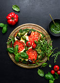 istock Pizza with green pesto and fresh tomatoes 1148189957