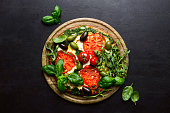 istock Pizza with green pesto and fresh tomatoes 1148189959