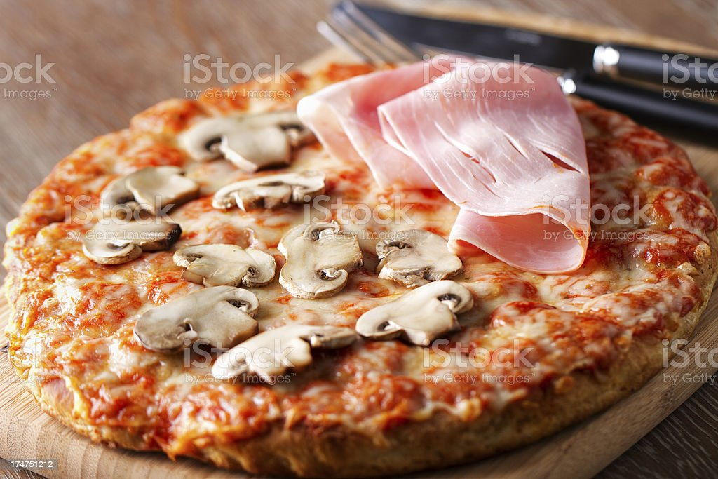 Pizza with ham and mushrooms. royalty-free stock photo