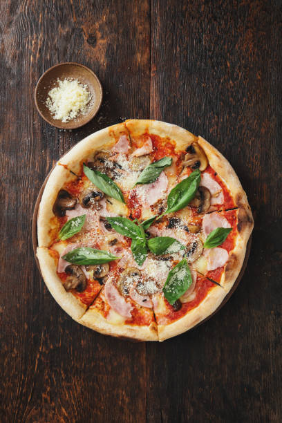Pizza with ham, mozzarella, mushrooms, herbs Pizza with ham, mozzarella, mushrooms, herbs pizza stock pictures, royalty-free photos & images