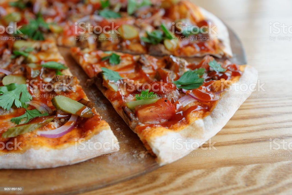 Pizza with meat and barbecue sauce stock photo