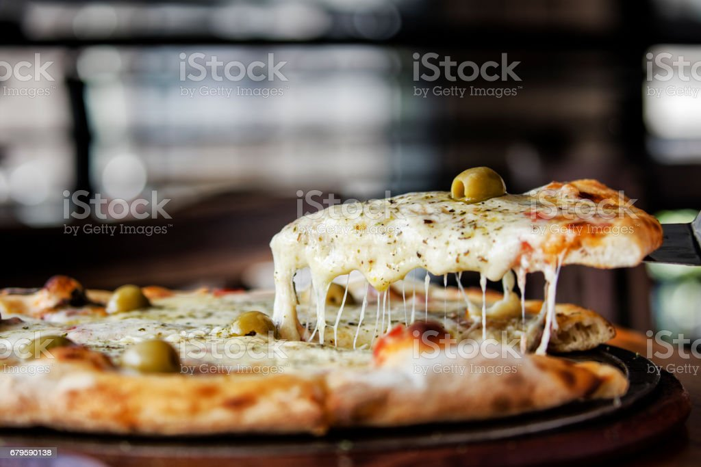 Pizza with melting mozzarella stock photo