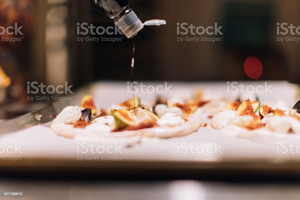 Pizza with Mozzarella di Bufala Campana and figs - Buffalo Mozzarella - Buffalo Cheese - Burrata Cheese stock photo