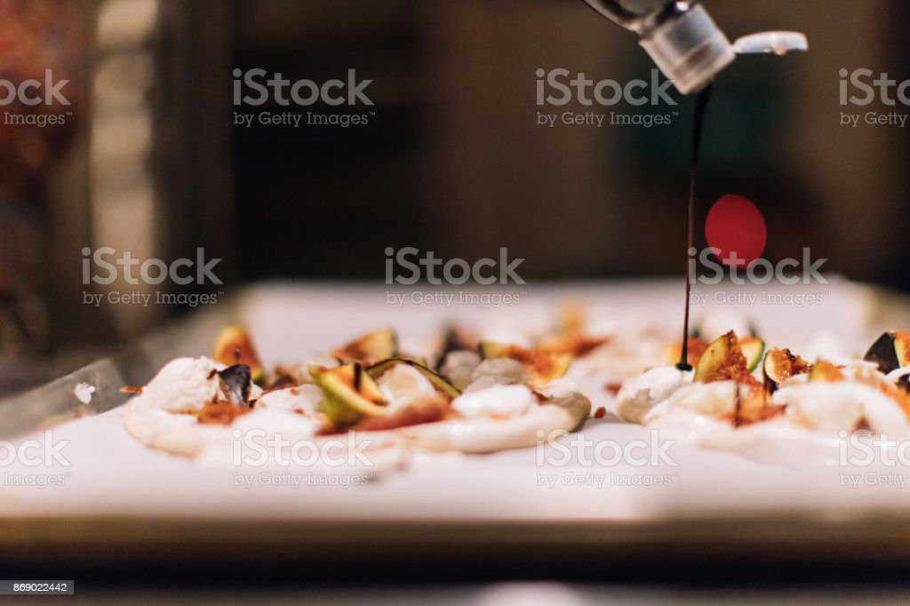 Pizza with Mozzarella di Bufala Campana and figs stock photo