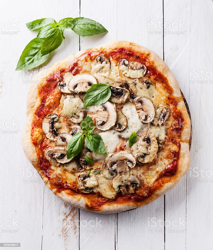Pizza with mushrooms and basil stock photo