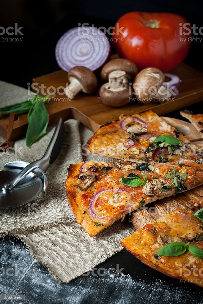 Pizza with mushrooms, red onion and tomato stock photo