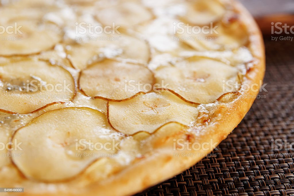 Pizza with pear and gorgonzola cheese stock photo