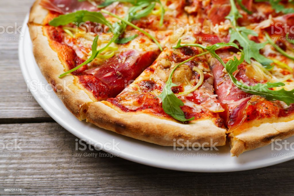 Pizza with prosciutto and arugula, close up royalty-free stock photo