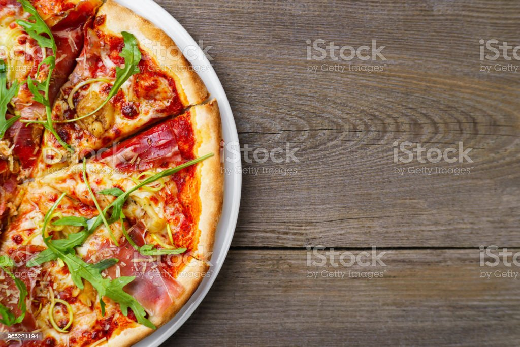 Pizza with prosciutto and arugula, copy space. royalty-free stock photo